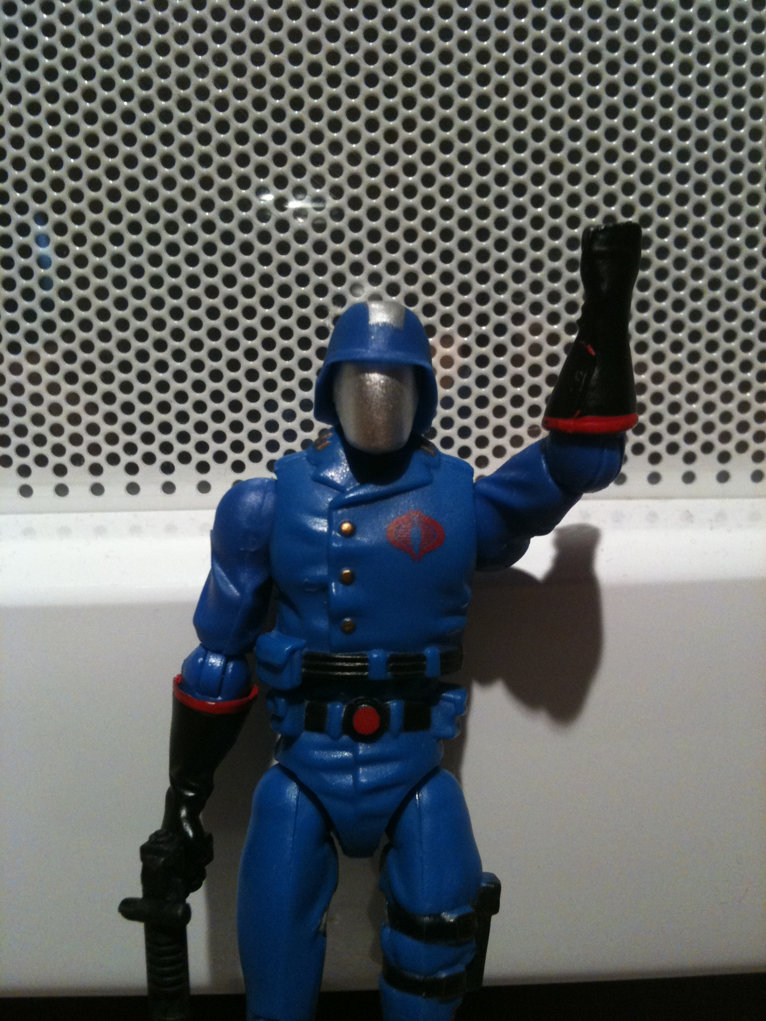 Cobra Commander action figure raising an angry fist.
